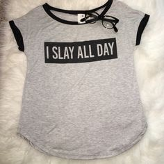 """Fashion Short Sleeve Tee - I Slay All Day  Hot trending soft fashion tee shirt """" I Slay All Day"""". Perfect with a pair of jeans or shorts and a messy bun! Material is so soft and has stretch to it. Available in sizes small thru x-large. Tops Tees - Short Sleeve"""
