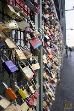 This bridge over the river Rhine in Köln (Cologne), Germany, is covered with locks. After placing the lock, the key should be thrown into the river. So, that is what we did.     http://viettelidc.com.vn