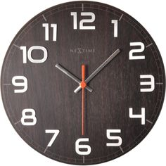 Classy Round in Walnut - 30cm  A bold wooden design with raised numbers that is both striking and subtle at the same time. An exciting design that combines the soft rounded edge of the clock, the color of the clock face with strong 3D extruded numbers. Available in two colors: beech and walnut.