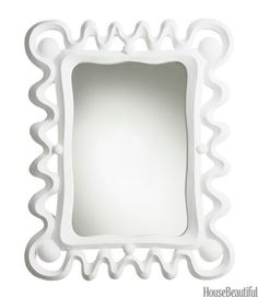 Mirrors - Inspired by hand carved Mayan Deco bas-relief found on buildings in Mexico, this plaster white mirror frame has been cast.