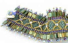 The Tila is a two-holed, flat bead that will open your world of designs. Beads Gone Wild's prize-winning designers believe the Carnival bracelet is a fun and engaging design that will usher you into t