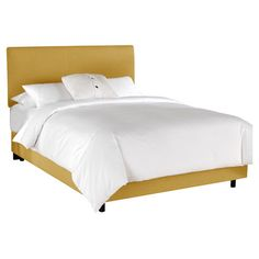 Wood bed with yellow linen upholstery. Handmade in the USA.   Product: BedConstruction Material: Solid wood and linen