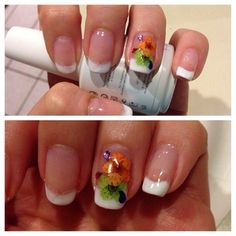 First attempt using gelish Polish so there was some bleeding. Dried flowers with rhinestones for some fun.