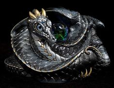 Google Image Result for http://windstoneeditions.com/sites/default/files/imagecache/product_full/coiled-dragon-silver-505-S_0.jpg