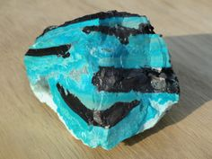Black tenorite in a cyan Chrysocolla matrix. Tenorite is a copper oxide, sometimes called black copper. Minerals intergrow like this in hydrothermal deposits with volcanic sublimate.