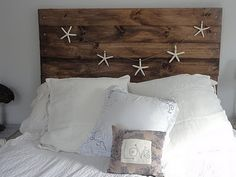 Our new DIY headboard. I like the look of the carriage bolts on the sides.