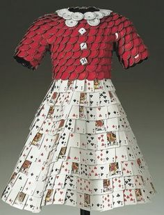 Art dress made of cards and bottle caps by John Petrey;  He reuses all sorts of materials from asphalt shingles, cards, bottle caps, bronze, shoe tags and more.