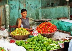 Chili Boy - Cairo, Egypt    Boy working at Khan El-Khalili Souk - islamic Cairo, Egypt. Puts things into perspective work instead of school