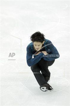 Takahiko Kozuka of Japan performs during the Men free skating of the ISU World Figure Skating Championships 2015 in Shanghai, China, 28 March 2015.(Imaginechina via AP Images)