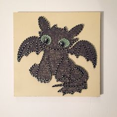 A personal favorite from my Etsy shop https://www.etsy.com/listing/533116565/toothless-string-art-how-to-train-your