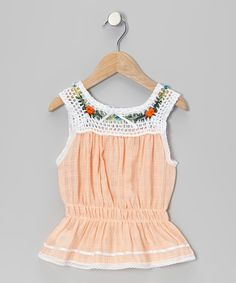 A crocheted knit expands across the neckline of this top, adorned with sweet floral accents and followed by a cinched waist. Part of an Ibiza-inspired collection, it fits breezy yet snug and is the perfect bouquet for tiny tulips to shine in.100% cottonMachine wash; tumble dryMade in Ecuador