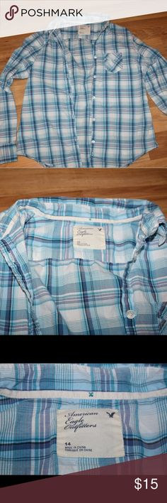 American Eagle plaid button up shirt Button up shirt with small pocket on front  Smoke free and pet free The size is really a 14 American Eagle Outfitters Tops Button Down Shirts