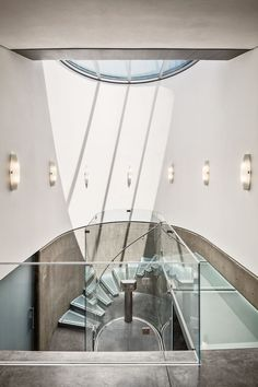 The staircase continues the theme of the home with the glass stair treads and raw concrete. ➤ To see more news about The Most Expensive Homes around the world visit us at www.themostexpensivehomes.com #mostexpensive #mostexpensivehomes #themostexpensivehomes @expensivehomes
