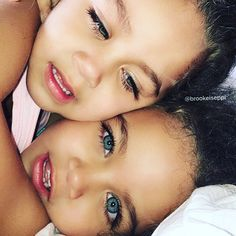 Gorgeous identical twin baby girls with amazing blue eyes framed by long lashes
