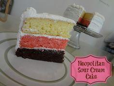 Neopolitan Sour Cream Cake #recipe via www.jmanandmillerbug.com