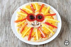 Good Food Recipes: Take Kids Snacking Into The Wild With Mangos Lion Pizza 4 servings Prep Time: 10 Minutes Cook Time: 8 Minutes  4 whole-wheat pitas  1 cup low-sodium pizza sauce  ½ cup shredded low-fat mozzarella cheese  ½ cup shredded low-fat cheddar cheese  8 pepperoni slices  8 black olive slices  1 large ripe mango, peeled, pitted, cut into thin strips  1 large red bell pepper, seeds removed, cut into thin strips  4 mushroom slices