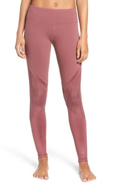 Definitely needing these sleek mid-rise leggings that feature lacy mesh insets.