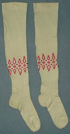 Girl's white machine-knitted cotton stockings with pink and ivory silk embroidery, English, mid-19th C.