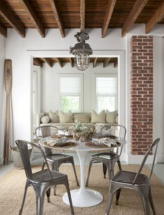 Dining Room. Transitional Dining Room. Cottage dining room. Cottage dining nook features rustic wood beams adorned with a vintage…
