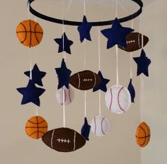 Champ- Basketball, football, and baseball. Sports nursery baby mobile. Www.facebook.com/graceannbaby