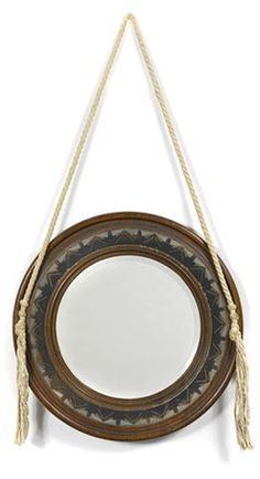 CARLO BUGATTI round wall mirror, partially ebonized walnut with pewter and copper inlay, 17-3/4 in diam.  |  SOLD $6,875 Bonhams Los Angeles, April 16, 2014