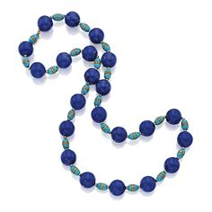 Gold, Lapis Lazuli, Turquoise and Diamond Necklace Composed of 22 lapis lazuli beads measuring approximately 18.2 to 18.0 mm, spaced by barrel-shaped turquoise beads and rondelles accented by diamonds, length 30 inches.