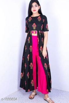 Checkout this latest Kurta Sets Product Name: *Women Rayon Assymetrical Printed Long Kurti With Palazzos* Kurta Fabric: Rayon Bottomwear Fabric: Rayon Sleeve Length: Short Sleeves Set Type: Kurta With Bottomwear Bottom Type: Palazzos Pattern: Printed Multipack: Single Sizes: M, L, XL, XXL Country of Origin: India Easy Returns Available In Case Of Any Issue   Catalog Rating: ★3.9 (325)  Catalog Name: Women Cotton Pleated Printed Long Kurti With Palazzos CatalogID_170659 C74-SC1853 Code: 605-1330654-6351