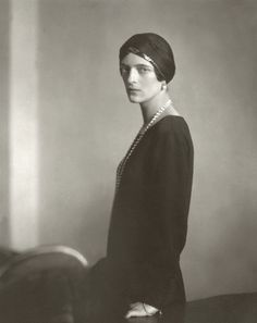 Edward Steichen, Princess Irina Alexandrovna Yusupov, ca. 1924 on Flickr. Princess Youssoupoff (formerly Grand Duchess Irini of Russia and also Princess Xenia) wearing a black dress with black turban, and an opera length strand of pearls, standing in profile by a table. —- Image by © Condé Nast Archive/CORBIS