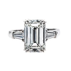 Gordon James 5.12 carat Emerald Cut 3 stone Diamond Ring; 5.60 carat total weight. Set in platinum. http://www.gordonjamesdiamonds.com/products/diamond-rings/tsr-835