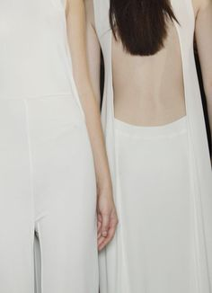 Backstage at Hussein Chalayan, S/S 2012 | recent collections of HC demonstrate the use of simplistic drape through the basic fall of lightweight fabrication.