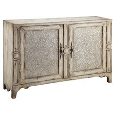 This 2-door sideboard showcases a hand-painted floral motif and weathered finish, perfect for adding a touch of country-chic style to your home.
