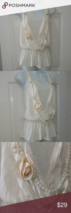 """🆕Soft & Feminine Anthropologie Mine Gauze Top Long strands of pearls & pretty rose adorn this gauzy cream top. Front drape & gently gathered waist. Poly/rayon blend says it can be machine washed & dried but I've never done this. It has been hand washed & air dried. Pearls can be removed AND there is a clasp attached to each side hoop for you to add one of your own necklaces!  Gently worn in excellent condition!! Measurements: Bust 16"""" across armpit to armpit, Elasticized Waist is 12.5""""…"""