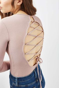 Bring the focus to the back in this ribbed body with long sleeves and lattice tie-back detail. In a neutral nude, style this versatile piece with anything from light wash jeans to a leather-look skirt. #Topshop