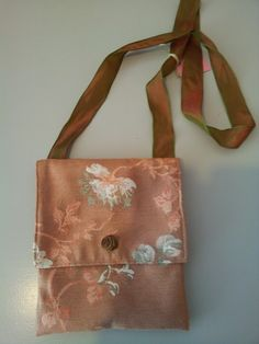 Little schoulderbag made from old curtain-fabric and ribbon.