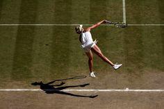 Eugenie Bouchard hits a serve during her Semi-final match - Scott Heavey/AELTC