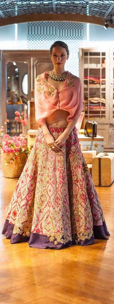 Cape style lehengas are here to stay and this gorgeous pastel pink purple lehenga is perfect for that sister of the bride look. #frugal2fab