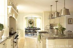 Ivory Kitchen... Awash in creamy ivory paint, the kitchen cabinets provide a subtle contrast to the room's blue walls.