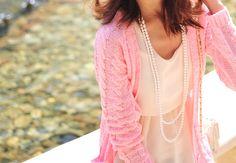 Pink cardigan + pearls