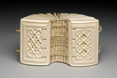 Miniature Book.  Elk bone, mica, linen thread, wooden pegs, handmade flax paper.  Shanna Leino