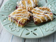 Layered with raspberry & cherry jams, sprinkled with a buttery streusel topping and drizzled with tempting glaze, these dessert bars are positively dreamy!