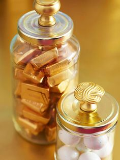 Clean out the jars and poke a hole in the top of the lid and screw a cabinet knob through the hole. We paired gold knobs with gold lids, but you can also pain the lids to match your hardware.
