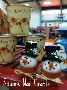 Snowmen in pots Buckets are painted with a Barb Jones design. www.facebook.com/squarenailcrafts