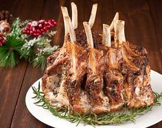 This crown roast of pork is flavored with garlic and fresh herbs. Tender, juicy and full of flavor, it makes a beautiful presentation for a holiday meal