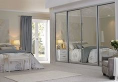Sliding wardrobes with arch detail #bedroomideas #glasswardrobes #fittedwardrobes #contemporarybedroom #bedroomfurniture