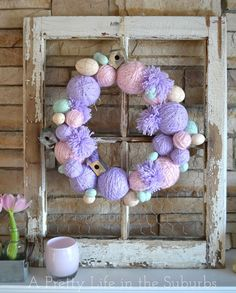 Make an Easter wreath with yarn. See how on HGTV Design Happens Blog...