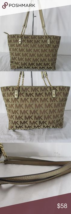 """Michael Kors MK Signature Jet Set Canvas Chain Tot Michael Kors MK Signature Jet Set Brown Gold Canvas Chain Tote Shoulder Bag Handbag.   Bag is in real good used condition. Bag has some light random scuffs and marks.  Lining has a dark ink stain as pictured.   Bag is missing leather tassel. Gold tone hardware.   Outside bag has a slip pocket. Top zipper closure.   Inside bag has a 4 slip pockets and a zipper pocket.   Measures 15""""W x 9""""H x 5""""D - strap drop 11"""".  100% authentic. Comes from…"""