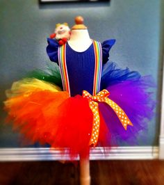 Rainbow Bright costume.  3T--all that's missing are the rainbow arm & leg warmers, and the red boots.  Twink will become a wand with a strategically placed stick :-).
