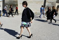 Street Style: Paris Fashion Week Spring 2015 – Vogue tiffany godoy in an isey miyake top and andrea crews skirt