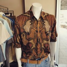 Bourgeois batik: vintage silk shirt $49, vintage hand tooled leather belt $59 #suave #suaveman #sleek #silk #batik #silkshirt #vintage #vintagefeels #bourgeois #handcrafted #handtooledleather #vintageleather #vintagebelt #belt #mens #man #coolman