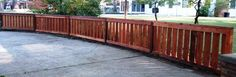 Semi-private cedar wood fence with top and bottom trim.  A twist on your traditional picket fence.
